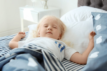 Cute little girl sleeping in bed at home
