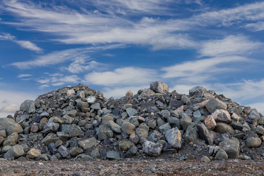 View of the granite piles with sky clouds.