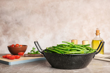 Dish with tasty green beans on table