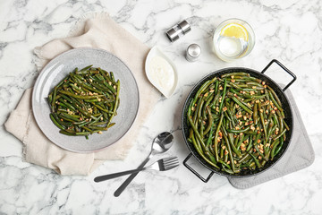 Yummy green beans with almonds served for dinner on table, flat lay