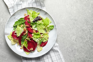 Plate with delicious beet salad on grey background, top view