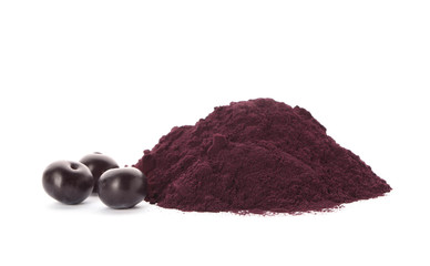 Pile of acai powder and berries on white background