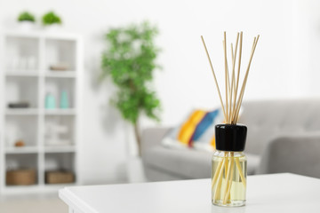 Aromatic reed air freshener on table in room