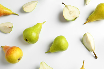 Fresh pears on light background, flat lay composition