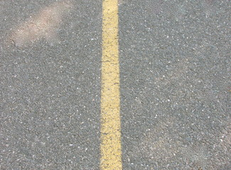 Yellow line on road.