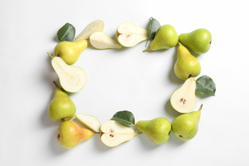 Frame made of pears on white background, top view