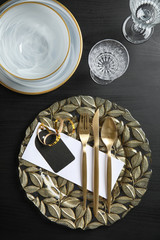 Elegant table setting on dark background, top view
