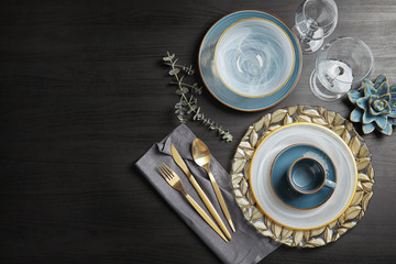 Elegant table setting and space for text on dark background, top view