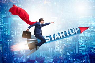 Superhero businessman in start-up concept flying rocket