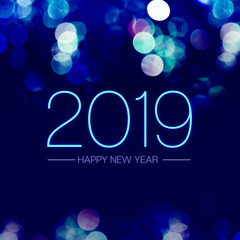 Happy new year 2019 with blue bokeh light sparkling on dark blue purple background,Holiday greeting card.
