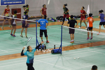 Indonesia badminton players are seen during exercise at national badminton camp in Jakarta