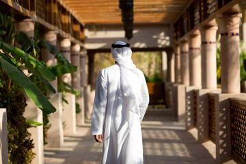 Emirati man walking outdoors.