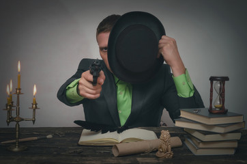 Detective spy agent holding in hands a gun and is aiming. Detective or spy agent or police inspector concept.