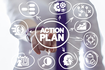Business woman clicks a action plan text button on a virtual drawing panel. Algorithm and strategy development business. Vision and forecasting.