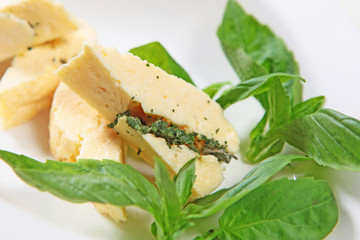 Soft halumi cheese with mint on a white background. Concept restaurant.