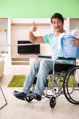 Disabled man on wheelchair doing laundry