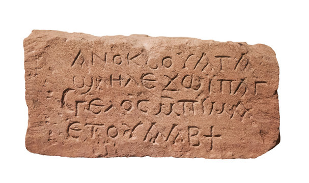 stone with ancient inscriptions isolated on a white background
