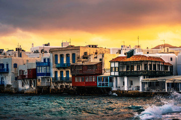 Colourful Traditional houses over the sea on a Mykonos island at sunset, greek little Venice