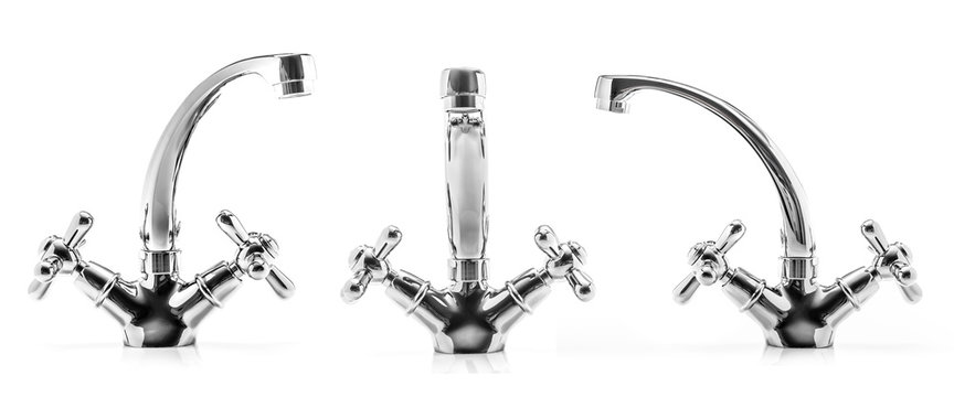 Modern metalic kitchen faucets isolated on a white background