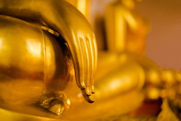 hands of the golden Buddha that hold the faith.