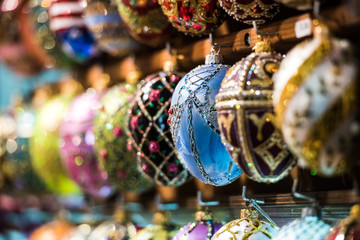 variety of colorful decorative egg toys at market