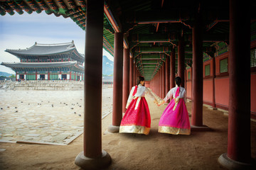 Korean lady in Hanbok or Korea gress and walk in an ancient palace