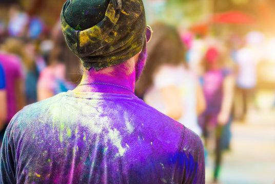 Colourful man on holi festival, backview