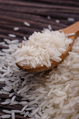 Jasmine rice on a wooden rustic background