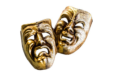 theatrical masks evil and good lie on a white background