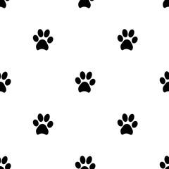 Seamless patterns with black animal footprints.