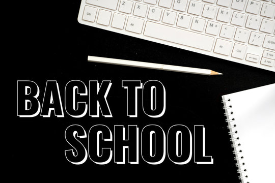 back to school, text over black board, keyboard and pencil