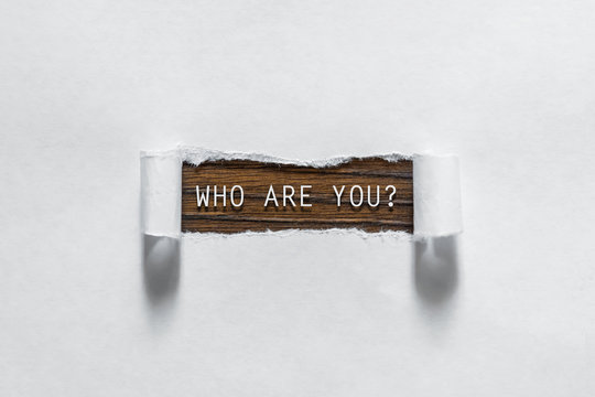 Who are you question written under torn paper.