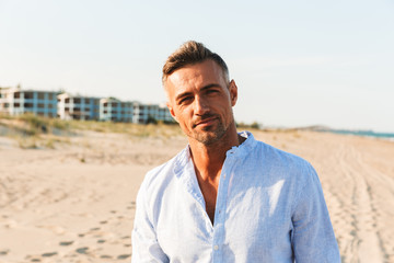 Portrait of a handsome man in shirt standing - fototapety na wymiar