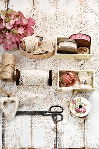 Vintage Style Flatlay Photo With Lace Trim Spools And Accessories