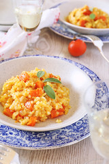 Pumpkin risotto and glass of wine white