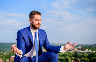 Businessman formal suit sit lotus pose and meditating outdoors. Entrepreneur find minute to relax and meditate. Man try to keep his mind clear. Relaxation technique. Keeping calm inside his soul