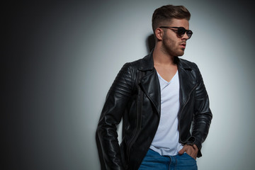 portrait of cool man with leather jacket and sunglasses