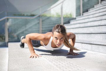 Strong determinated girl training in the street