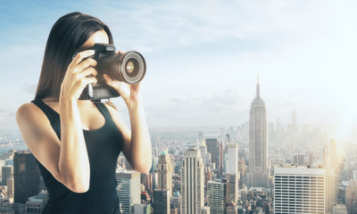 Woman taking photo on city background