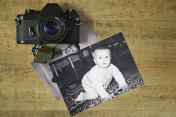 An old film camera and some baby photos.
