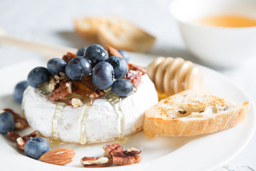 Camembert cheese with honey, nuts and fresh blueberries