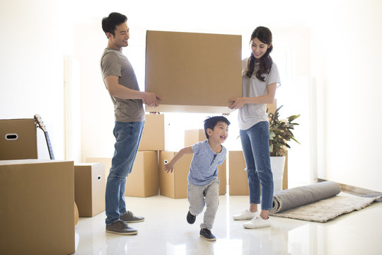 Happy young family moving to a new house