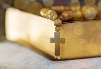 Closeup of wooden Christian cross necklace next