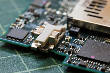 Electronics background technology close up of the green kit circuit board. Application Specific Integrated Circuit.