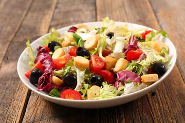 vegetable salad on wood background