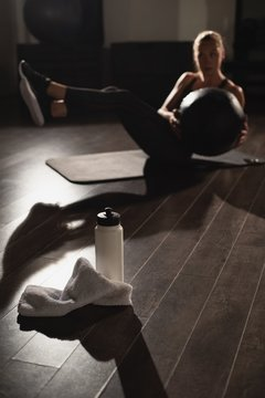 Woman doing exercises with medicine ball