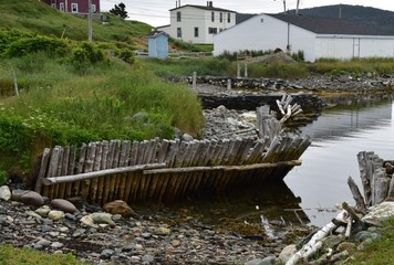landscape around the Irish Loop; wooden posts at the waterfront at  the Colony of Avalon archaeological site in Ferryland;  Avalon Peninsula Newfoundland,  Canada