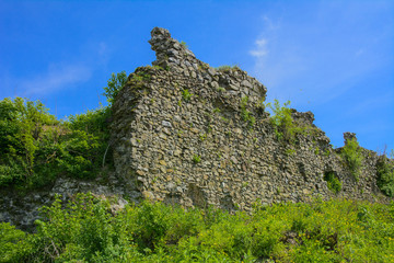Ancient ruins of the castle of the town of Khust (Dracula Castle). a huge and powerful castle that performed a defensive function and played an important role in many battles. Western Ukraine, Europe