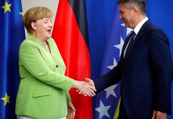 German Chancellor Merkel shakes hands with Bosnia-Herzegovina's PM Zvizdic at the chancellery in Berlin