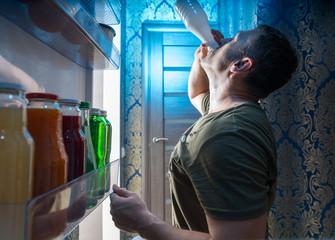 Thirsty man with eating disorders drinking yogurt
